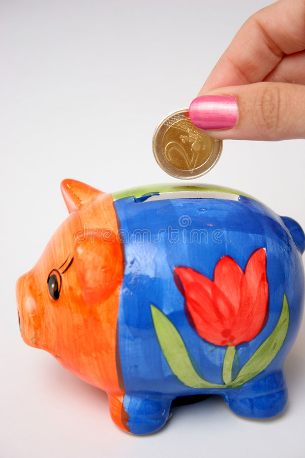 Coin and piggy stock images