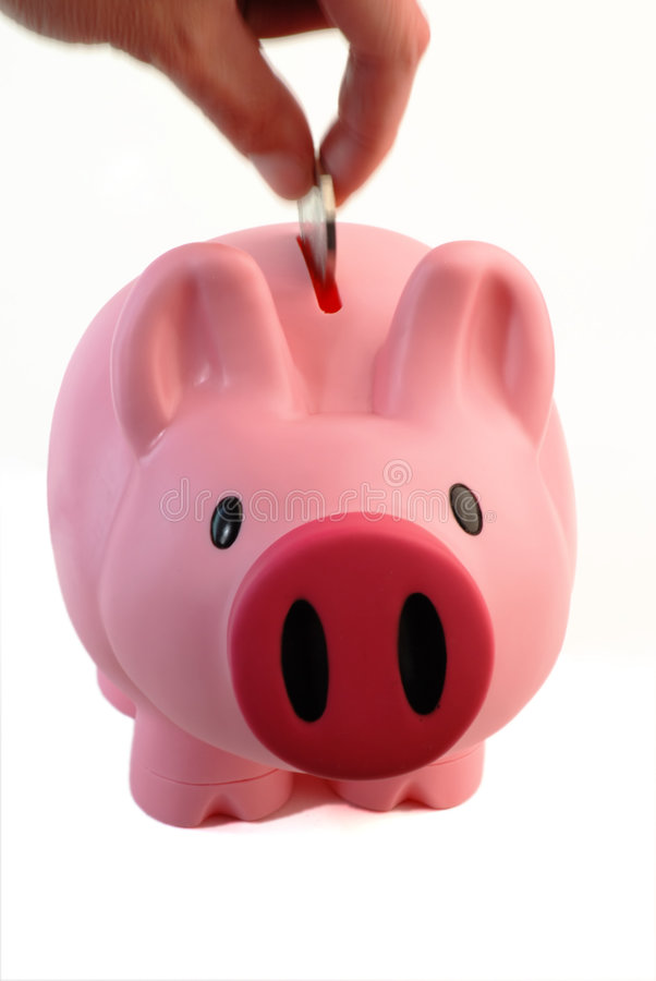 A coin in the piggy bank stock photo