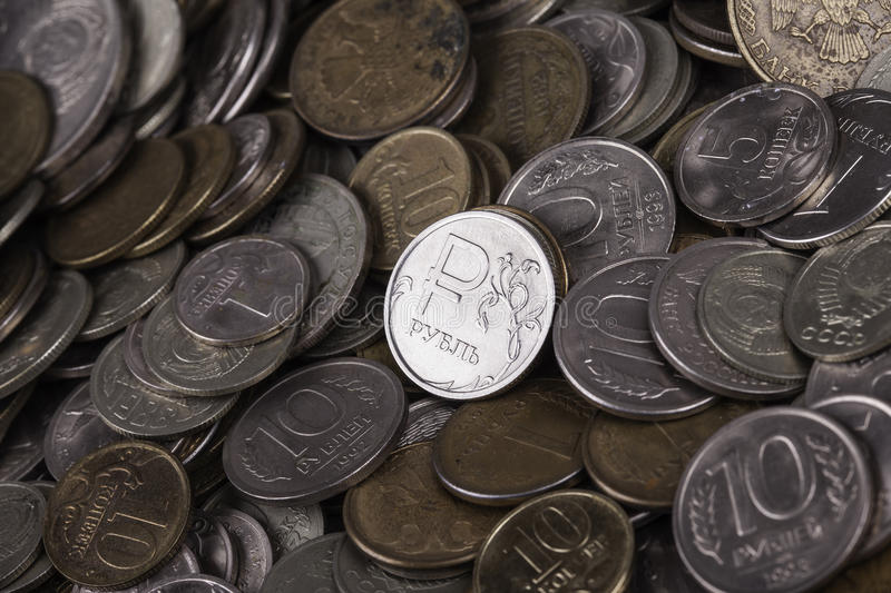Coin ruble among many other coins. Coin ruble closeup among many other coins stock image