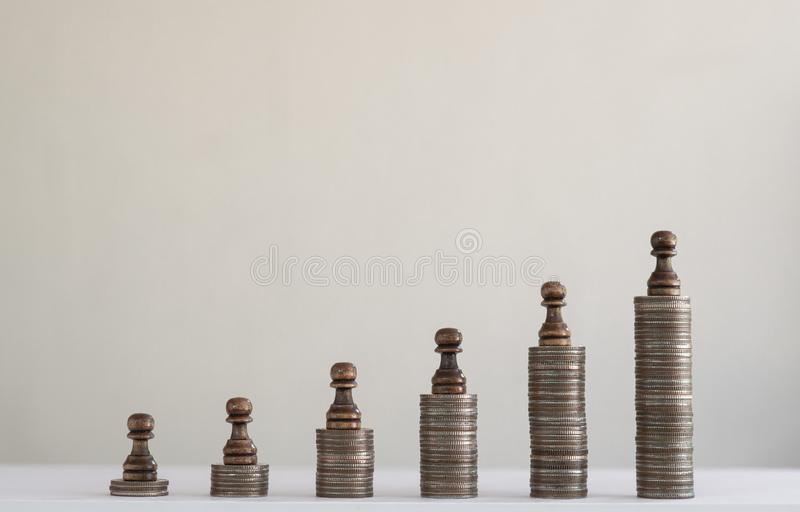 Coin stacks arranged into growth chart on white background, finance and business concept. Copy space, clock, time, analog, financial, saving, coins, money stock photo