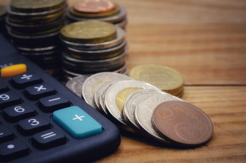 Coin stacks on table royalty free stock image