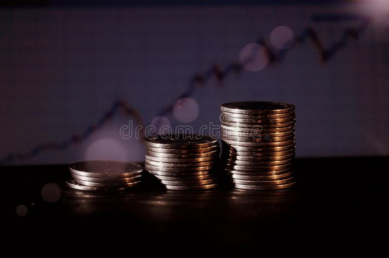 Coin steps with blue graphic blurred background royalty free illustration