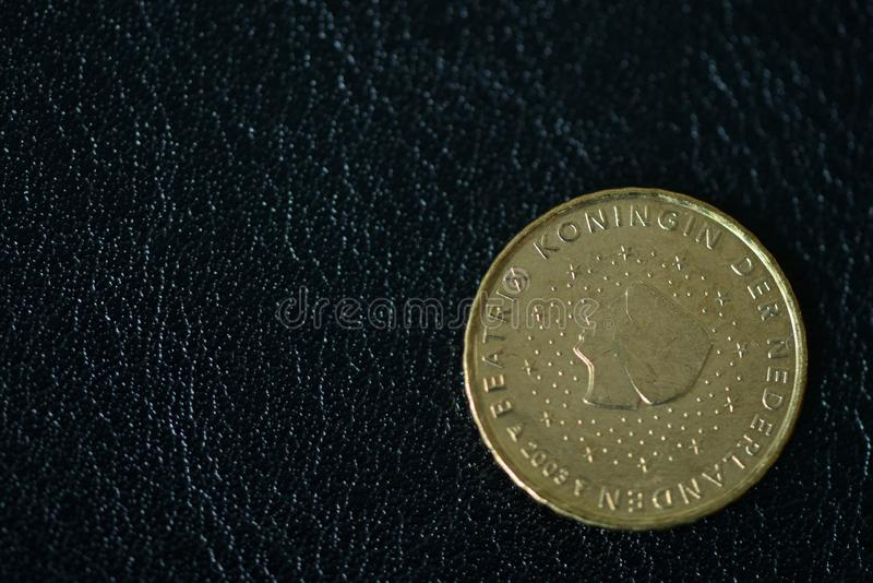 Coin in ten euro cents on a dark background stock images