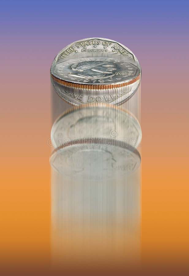 Coin toss. Dollar coin flipping through the air on blue and orange royalty free stock photography