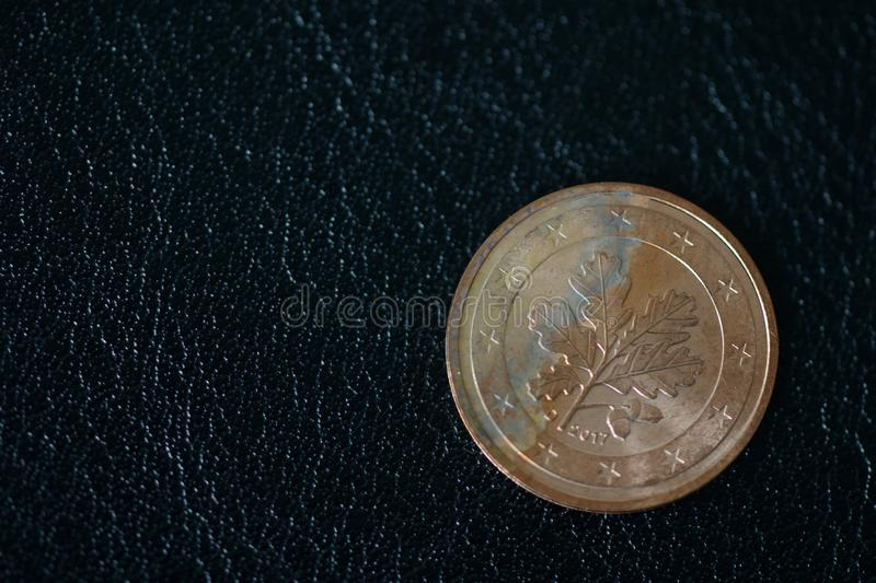 Coin in two euro cents on a dark background royalty free stock photo