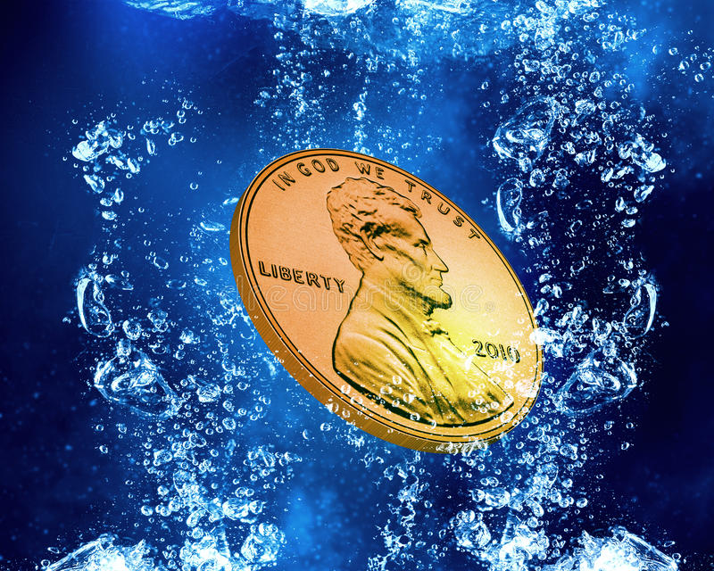 Coin under water stock photography