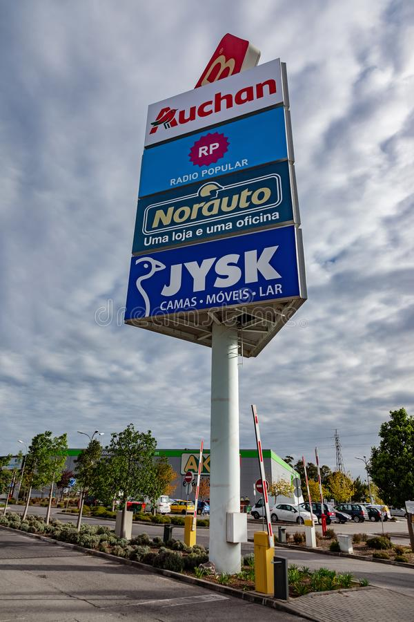 Tall advertising pillar or column marketing shops in the Barreiro Planet Retail Park stock images