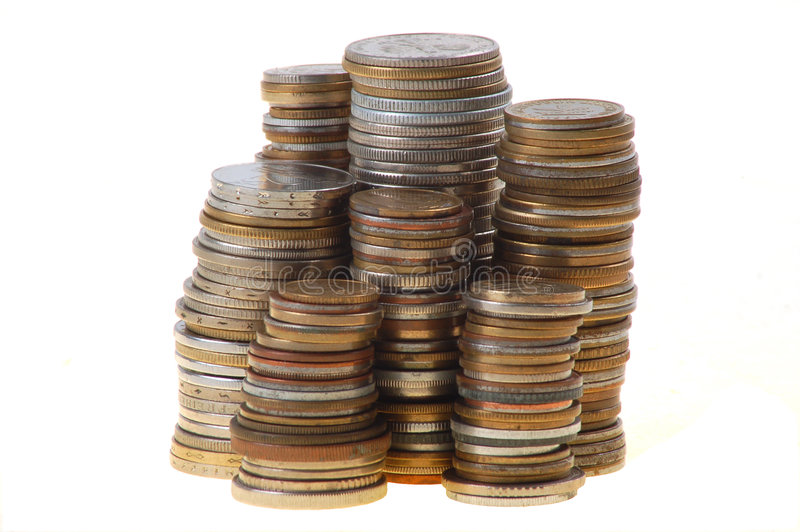 Coins. Stack of coins on White background royalty free stock photography