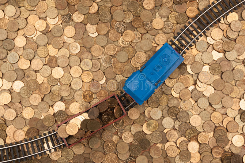 Coins background and toy train. Pictured on the placer Russian coins ten cents and toy train stock photo
