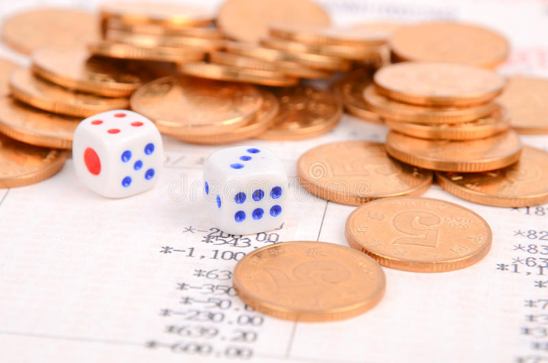 Coins,bank book and dice royalty free stock images