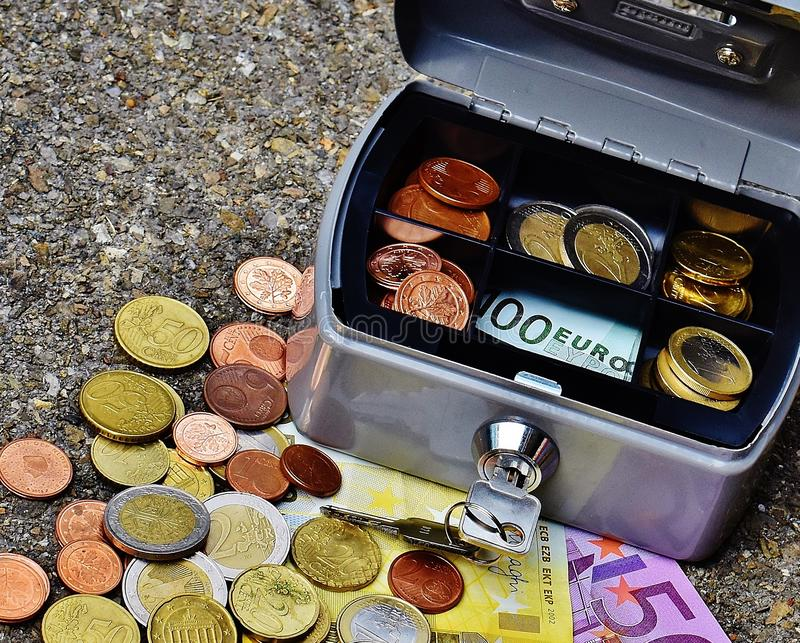 Coins and banknotes in metal box