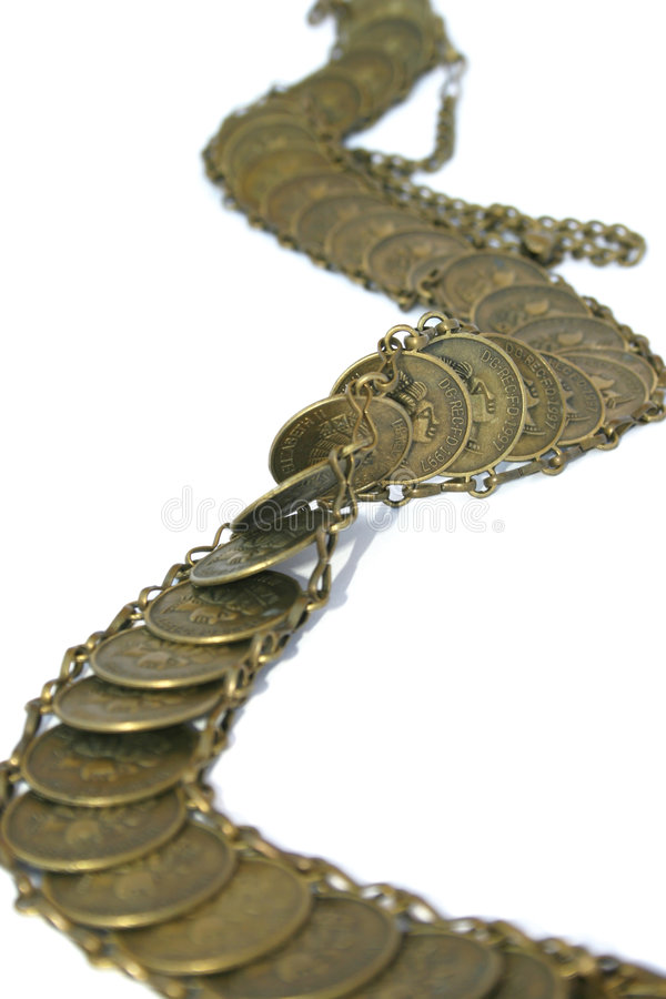 Coins belt. Beautiful coins belt isolated on the white stock image