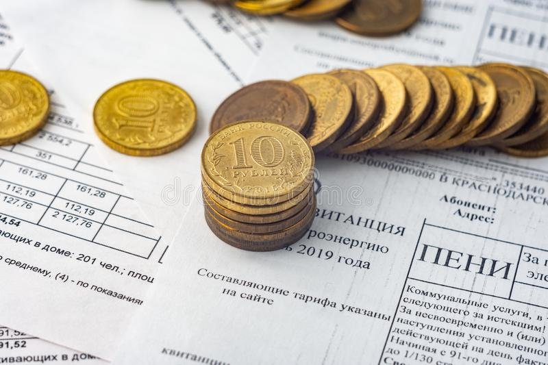 Coins are on the bills, penalties for electricity. Coins are on the bills, penalties for  electricity stock images