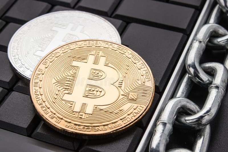 Coins bitcoin on dark keyboard. Metal chain. Concept of blockchain technology. stock photo