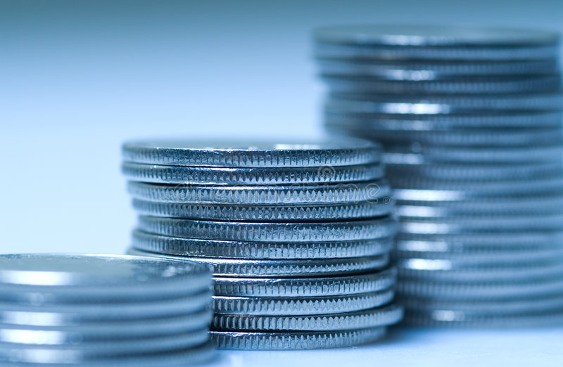 Coins in blue stock photography