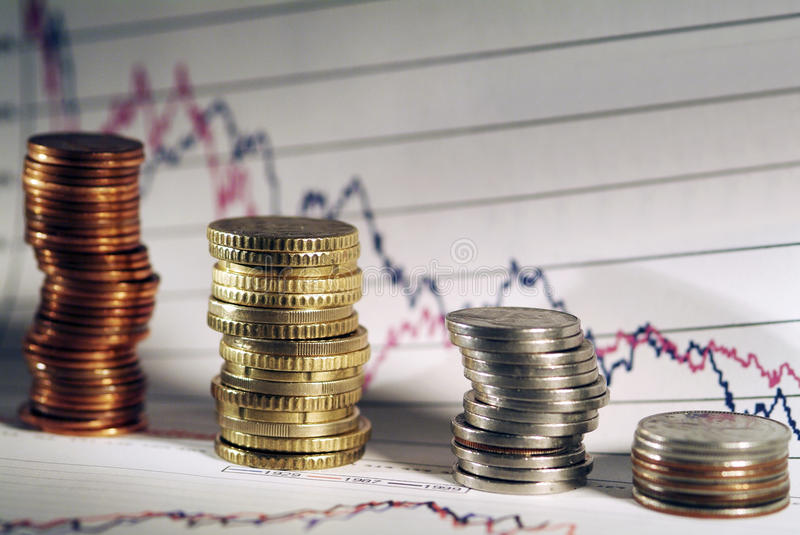 Coins with Business diagram. On financial report . Shallow focus stock photo