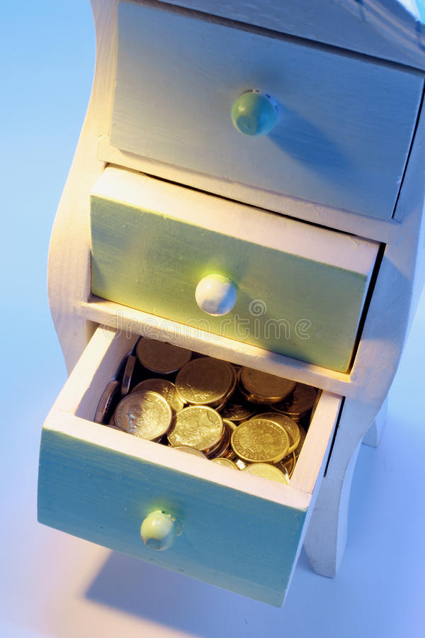 Download Coins in Chest of Drawers stock photo. Image of investment - 21046292