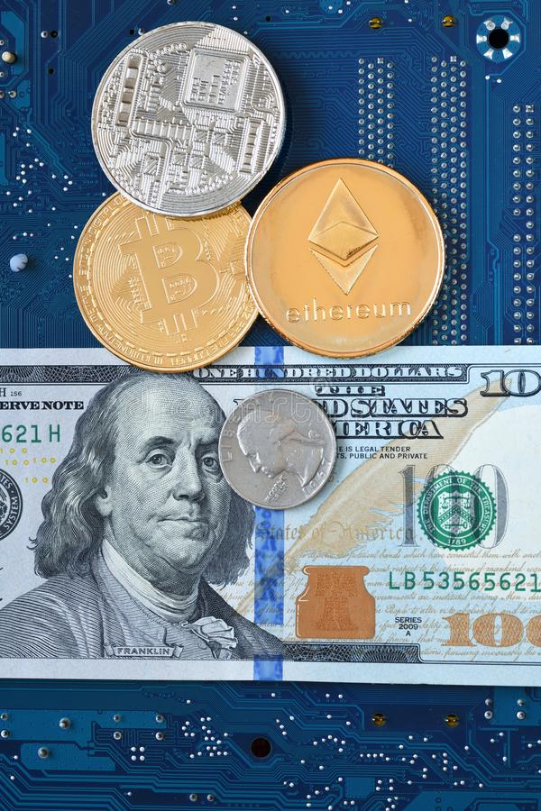Cryptocurrency Ethereum, Bitcoin. Coins of cryptocurrency Ethereum, Bitcoin, dollar banknote and a quarter of a dollar on the blue computer board stock photos