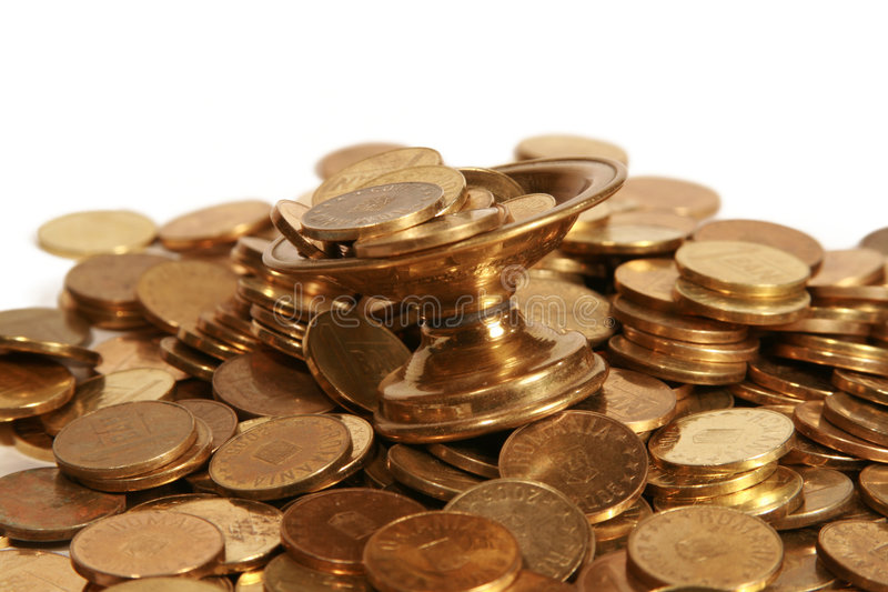 Coins in the cup royalty free stock photography