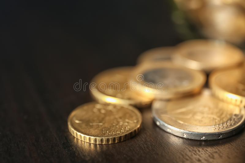 Coins on dark table, closeup. Concept of savings royalty free stock images