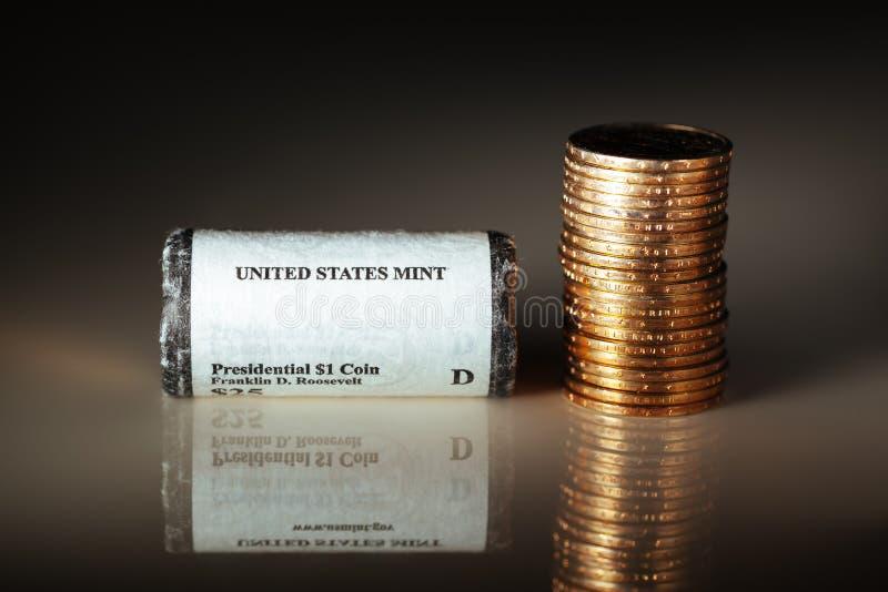 coins den guld- dollaren arkivfoto