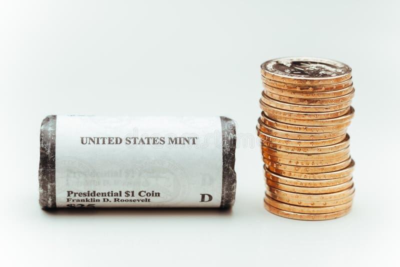 coins den guld- dollaren arkivbild