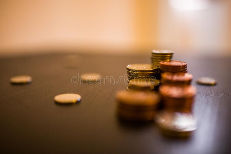 Coins on desktop stock photography