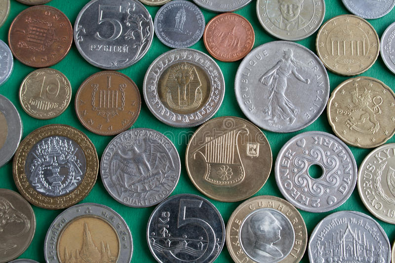 The coins from different countries stock image