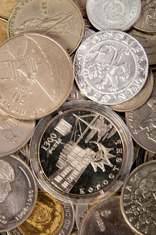 Coins of different countries. coin collection. Background of the collection of the coins of the different countries stock image