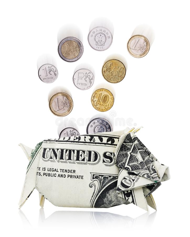 Coins of different countries fall in a piggy bank stock image