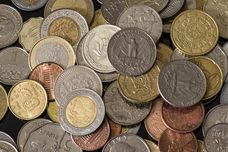 Coins from different countries. Nice money background. royalty free stock image