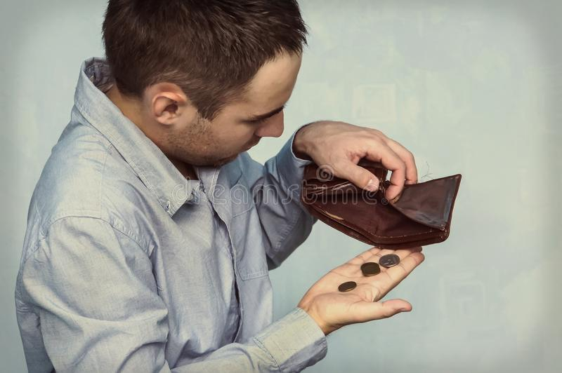 Coins and an empty wallet stock photography