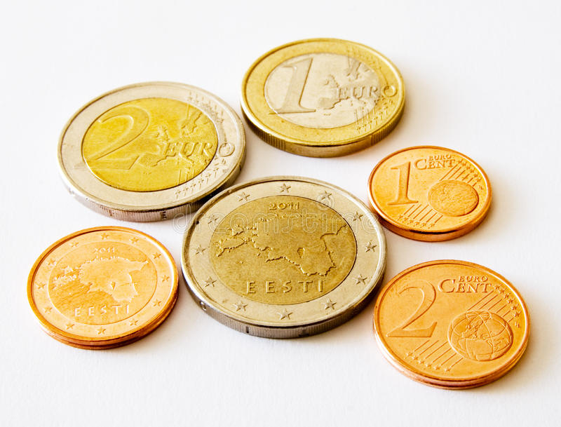 Coins of Estonia (euro and cents). Coins of Estonia with national graphic on the light background royalty free stock photo