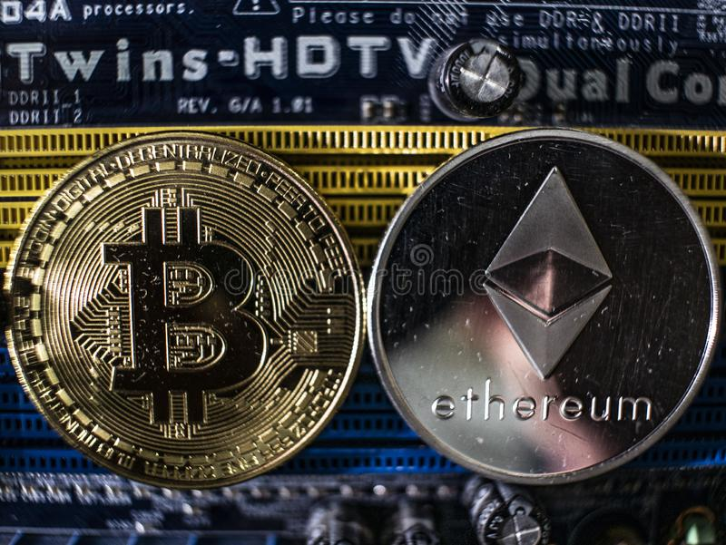 Coins of ethereum and bitcoin on the background of the chip. Cryptocurrencies close-up. cryptocurrency mining concept royalty free stock image