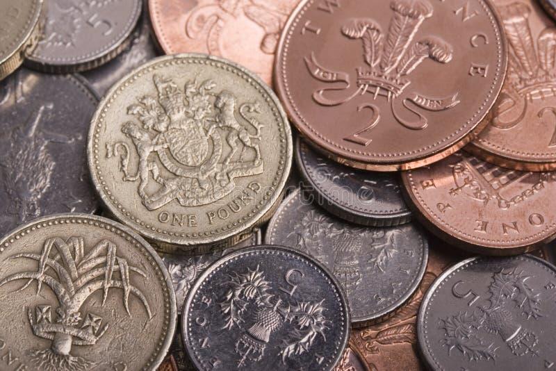 coins ett pund sterling royaltyfria foton