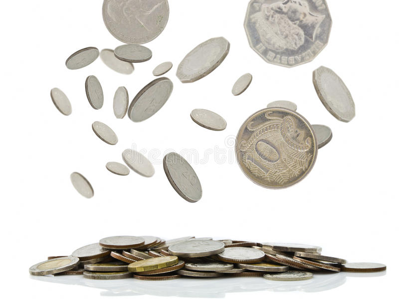 Coins falling. And pile of money stock photo