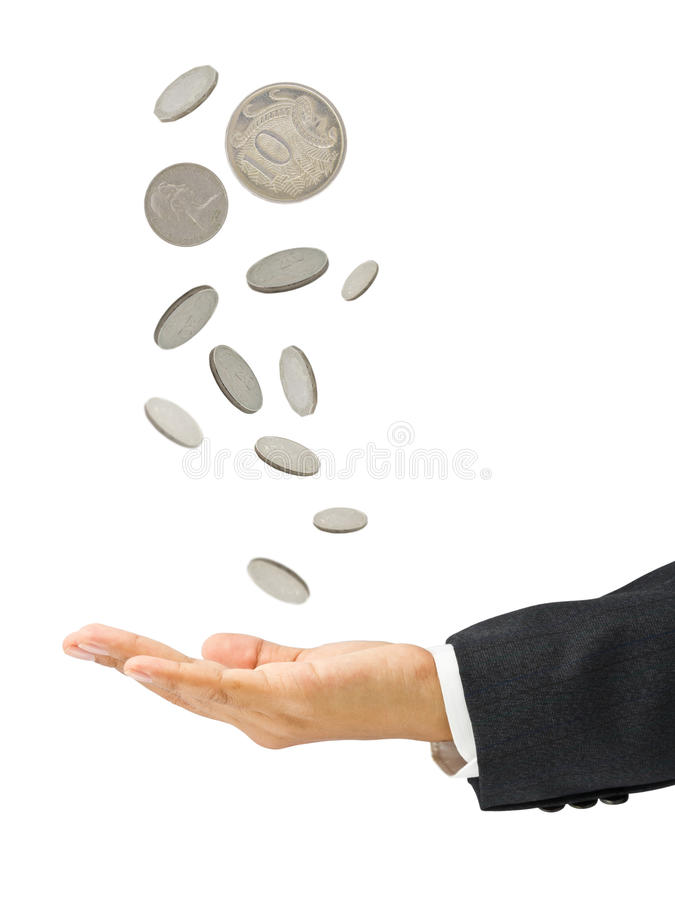 Coins falling. Down to the business's hand stock photos