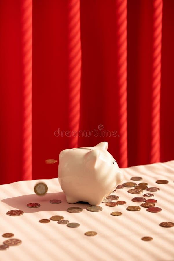 Coins falling into piggy bank. Money savings concept royalty free stock image
