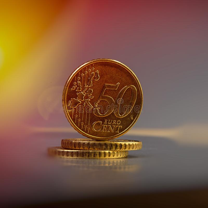 Coins of fifty euro cents lie on a pile of coins. Coins on the b stock photography