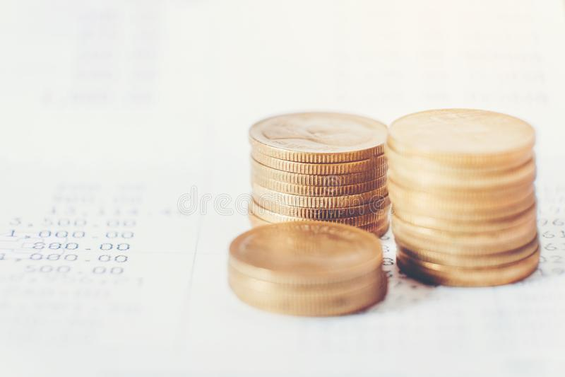 Coins for finance and banking on digital stock market financial exchange and Trading graph.  royalty free stock photo