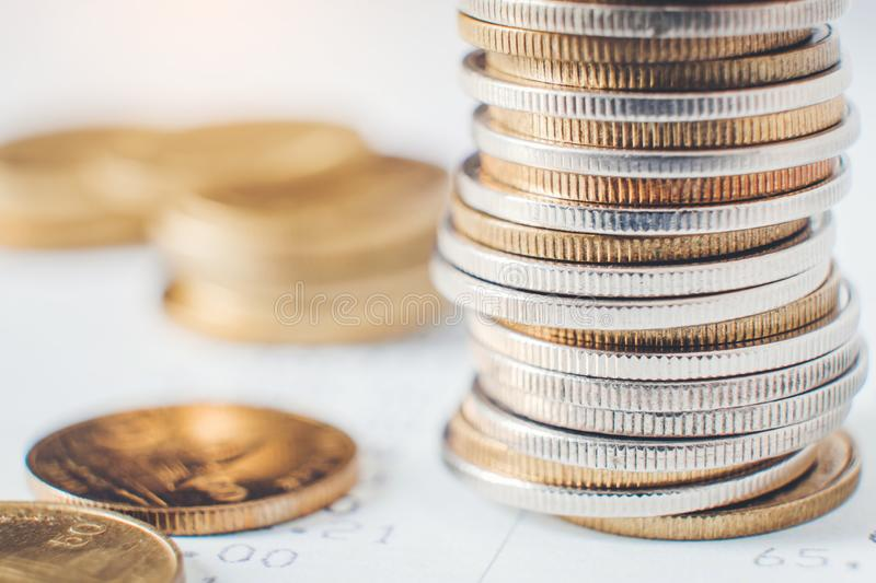 Coins for finance and banking on digital stock market financial exchange and Trading graph.  royalty free stock photography
