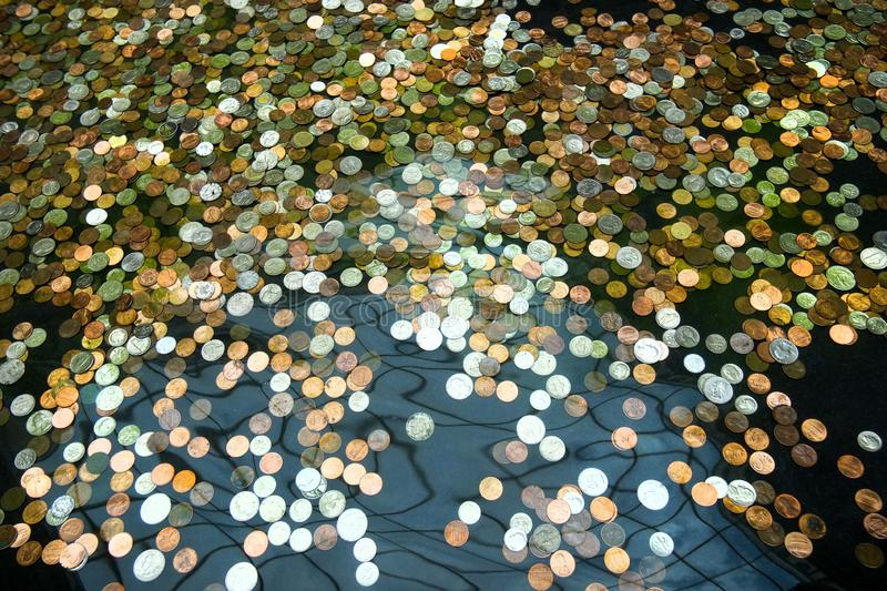 Coins in a fountain, wishes for prosperity royalty free stock photo