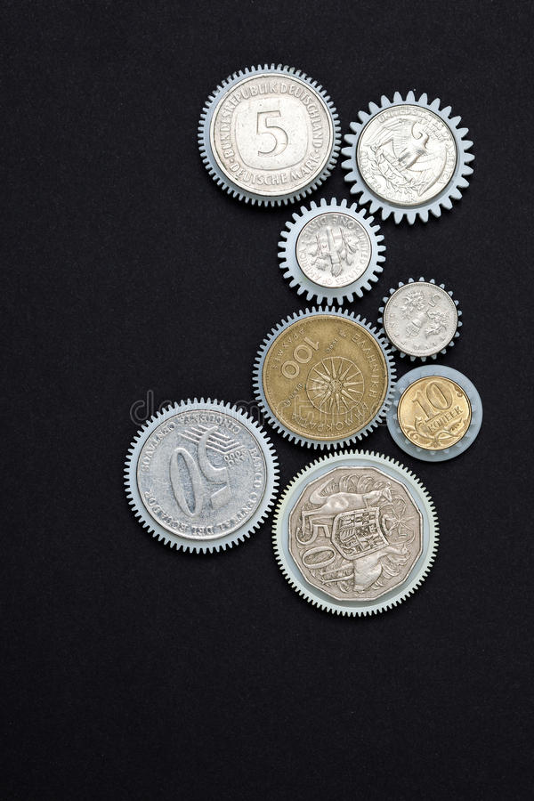 Coins gearwheels. Business concept. money works stock photo