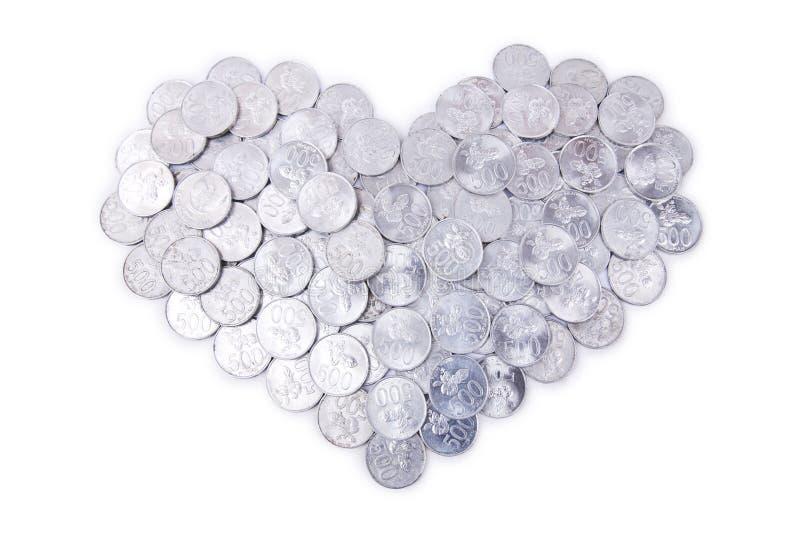 coins gjord hjärta arkivfoto