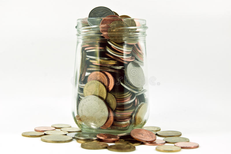 Coins in glass jar. An image is a financial concept royalty free stock photography