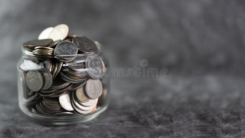 Coins in glass jar Savings and investment royalty free stock photos