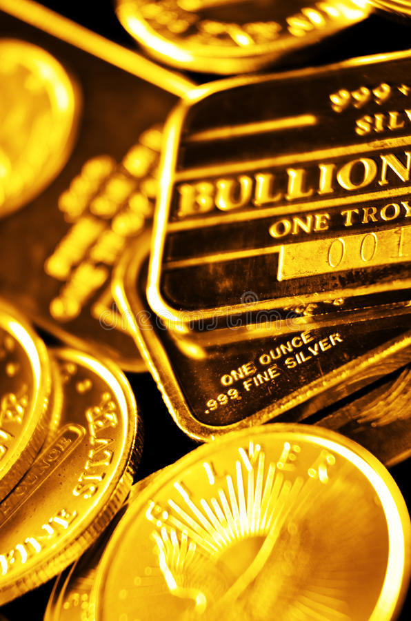 Coins of Gold and Bars for Wealth and Riches. Gold coins and bars illustrating wealth and riches stock photo