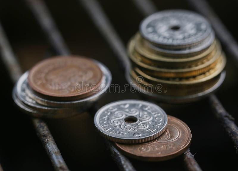 Coins on grill grid stock images
