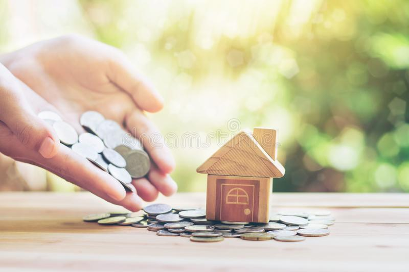 Coins growth up to profit concept investment and finance. House put on coins. royalty free stock images