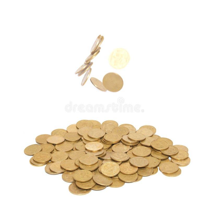 coins guld- regn royaltyfri fotografi